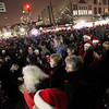 Record-Eagle/Jan-Michael Stump<br /> The Ladies' Grand Traverse Chorus leads the crowd in Christmas carols before Santa Claus' arrival in downtown Traverse City Friday evening to light the downtown Christmas tree.