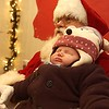 Annalynn Dahn, 6 weeks old, of Traverse City, sleeps through her encounter with Santa Claus.