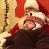 Annalynn Dahn, 6 weeks old, of Traverse City, sleeps through her encounter with Santa Claus.