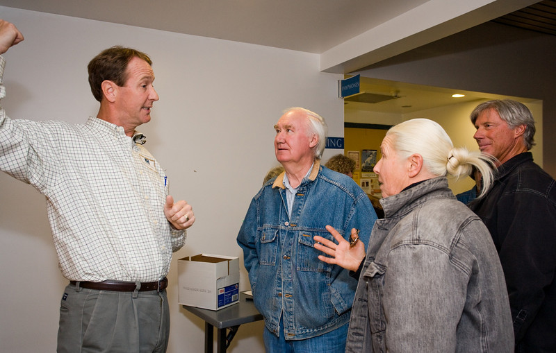 Tecton Vice-President, Chris Fling,  tells Santa Fe resident Forrest Fenn and others that the room is full and they have to go outside to the patio.