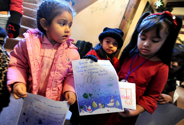 "Alexa Valles, left, Marisol Chihuahua, and Jayline De La Cruz, hold letters they wrote to Santa during a visit to Santa's House at the Pi Beta Phi sorority.<br /> The house will be open from 10 a.m. to 4 p.m. December 5th and 6th and helps raise money for  local children's charities. For more photos and a video, go to  <a href=""http://www.dailycamera.com"">http://www.dailycamera.com</a>.<br /> Cliff Grassmick / December 3, 2009"