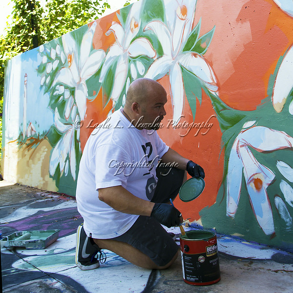 Luis Berros working on his mural (@luisberros)