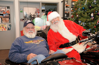 """""""Summer Santa"""" Dave Sweigert of Hamburg, who portrays Santa for Schaeffer's """"Christmas in July"""" charity event stops in for a visit with """"Christmas Santa"""" portrayed by Bob Gingrich of Bethel."""