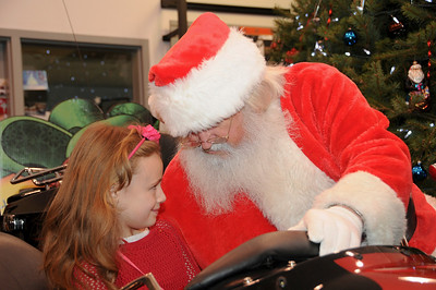 Six year-old Eva Kambacis assures Santa that she was the best of all girls in 2013.  Blandon, PA