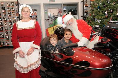 "Roman (age 5) and Gino (age 3) Scala with Santa and Mrs. Claus at Schaeffer's Harley-Davidson's annual ""Pictures with Santa"" event.  Orwigsburg, PA"