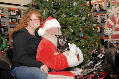 It's hard to tell who's happier to see Santa, Jamie Zimmerman or Rico her Chihuahua.  Pine Grove, PA