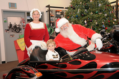 "Landyn Sterner (age 5) with Santa and Mrs. Clasus at Schaeffer's Harley-Davidson's annual ""Pictures with Santa"" event.  Orwigsburg, PA"