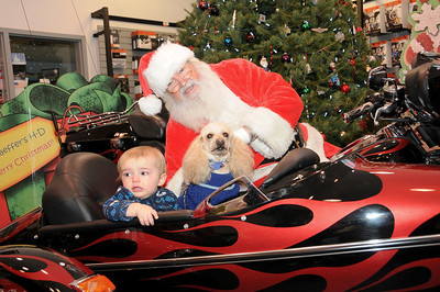 """Two year-old Parker Hess seems to be looking for the nearest exit while his dog Kody is thinking, """"Let's just get this over with…and give me my treats!""""  Orwigsburg, PA"""