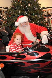 "Five year-old Lynnse Schmeck poses with Santa Claus at Schaeffer's Harley-Davidson's annual ""Pictures with Santa"" event. Kutztown, PA"