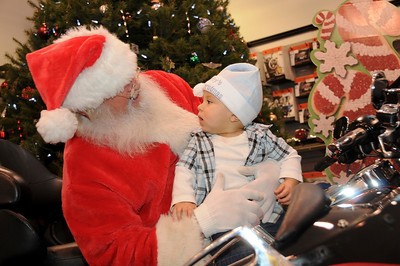 "8 month-old Anthony Gonzalez was sporting his brand new ""Baby's First Christmas"" hat for his visit with Santa.  Pottsville, PA"