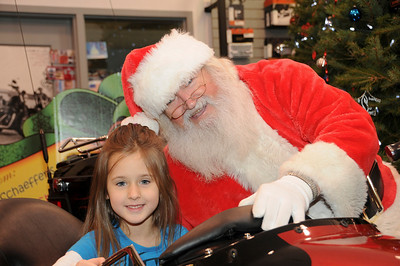 """Five year-old Tallica Hearn has her picture taken with Santa at Schaeffer's Harley-Davidson's annual """"Pictures with Santa"""" event.  Orwigsburg, PA"""