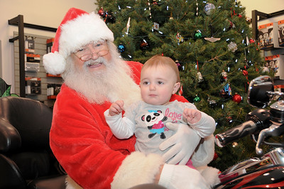 """One year-old Trinity Bell  sits on Santa's lap at Schaeffer's Harley-Davidson's annual """"Pictures with Santa"""" event.  Bernville, PA"""