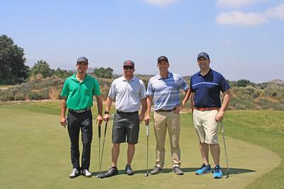 Left to right: Neil Perlmuter, Chris Nassour '99, Chris Farlow '93 and Brett Twente.