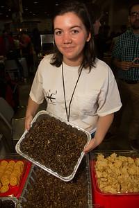Laura Kraft-U, of Georgia, entomology student offers snacks of grub worms