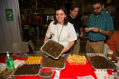 Laura Kraft-U, of Georgia,  entomology  student offers snacks of grub worms and crickets
