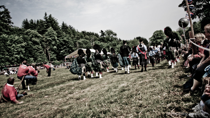 Pipeband passes by