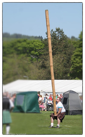 Craig Smith attempts to Toss his Caber