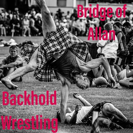 Robert Clark, world champion wrestler performs a kilted cartwheel at Bridge of Allan Highland Games 2005