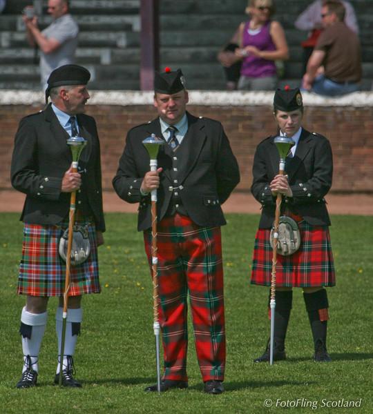 Three Drum Majors