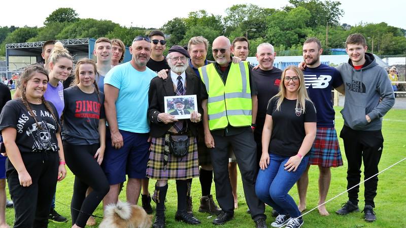 Photographer Richard Findlay (FotoFling Scotland) presents Backhold Wrestling Guru, William Baxter with a Photobook Tribute
