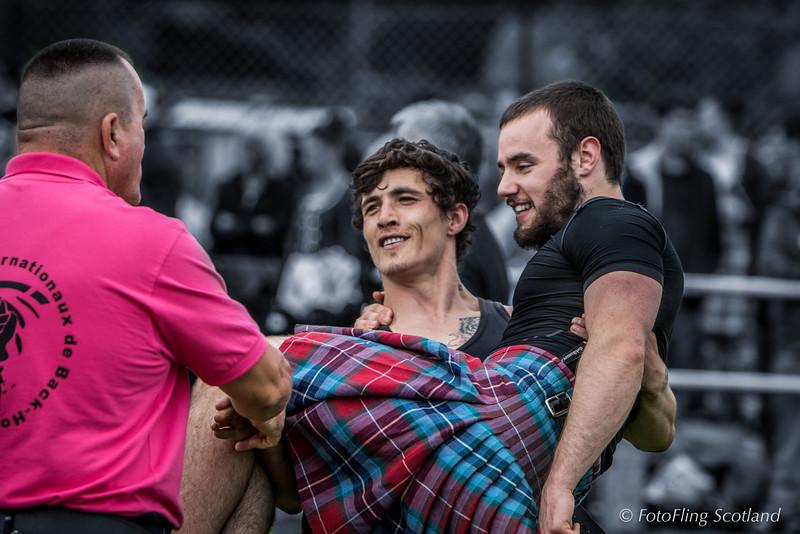 Injured Paul Craig carried by fellow Wrestler, George Reid