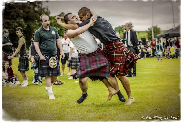 Anton Antonov and Scott Robin Lindsay wrestle at Ceres Highland Games 29 June 2013