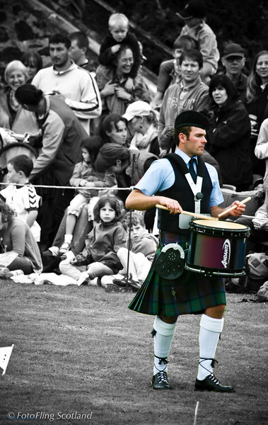 Standing out from the crowd<br /> Drummer of the Isle of Skye Pipeband, Portree Highland Games 2008