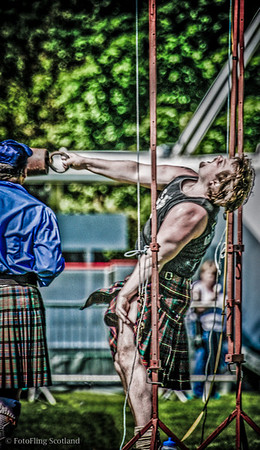 Heave ! Craig Smith hurles the weight over bar at Bathgate & West Lothian Highland Games 2009