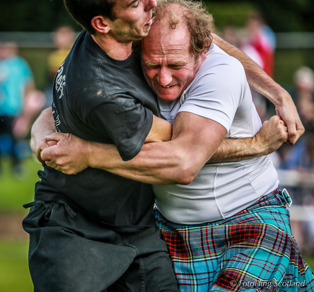 Michael Phillips wrestles with Breton at Bute Highland Games 2013