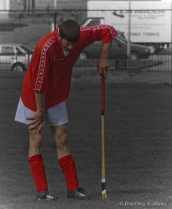 Shinty Player takes a rest