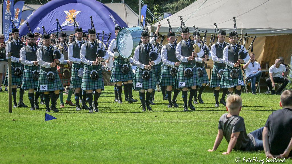 Pipe Band enter the Games Field