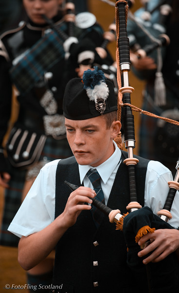 Holding the chanter Isle of Skye Pipeband at Portree Highland Games 2008