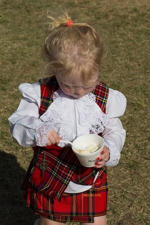 Blondie in kilt eating ice cream 9286