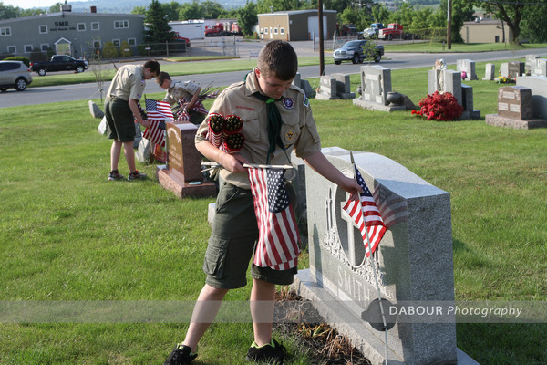 Boy Scout Mason Maury, 14 from Pohatcong Township puts out a US flag on a grave site.