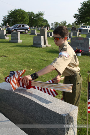 Boy Scout Chris wentworth, 14 from Pohatcong Township puts out a US flag on a grave site.