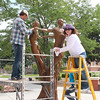 Joe Dugas and Sarah Polak providing sculpture care to the Three Muses.  (photo by Bethany Cook)