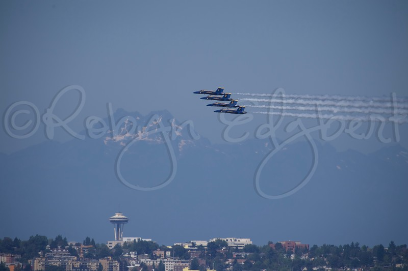 US Navy Blue Angels in formation with smoke over Seattle skyline