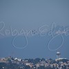 US Navy Blue Angels in diamond formation over Seattle skyline