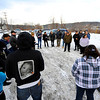 A photo of missing 5-year-old Jeremiah Oliver can be seen on the back of a family member's sweatshirt as a group meets in a parking lot on Kimball St. in Fitchburg before heading to make their search for Oliver in the woods off Meadowbrook Lane, Saturday.<br /> SENTINEL & ENTERPRISE / BRETT CRAWFORD