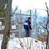 Sandrino Oliver, searches for his missing 5-year-old nephew Jeremiah Oliver in the woods off Meadowbrook Lane in Fitchburg, Saturday.<br /> SENTINEL & ENTERPRISE / BRETT CRAWFORD