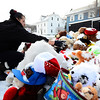 Judy Reardon of Fitchburg brushes snow off a make-shift memorial for missing 5-year-old Jeremiah Oliver in a parking lot on Kimball St. across from the apartment building where Oliver lived, Saturday before volunteering to help search for the missing boy in the woods off Meadowbrook Lane.<br /> SENTINEL & ENTERPRISE / BRETT CRAWFORD
