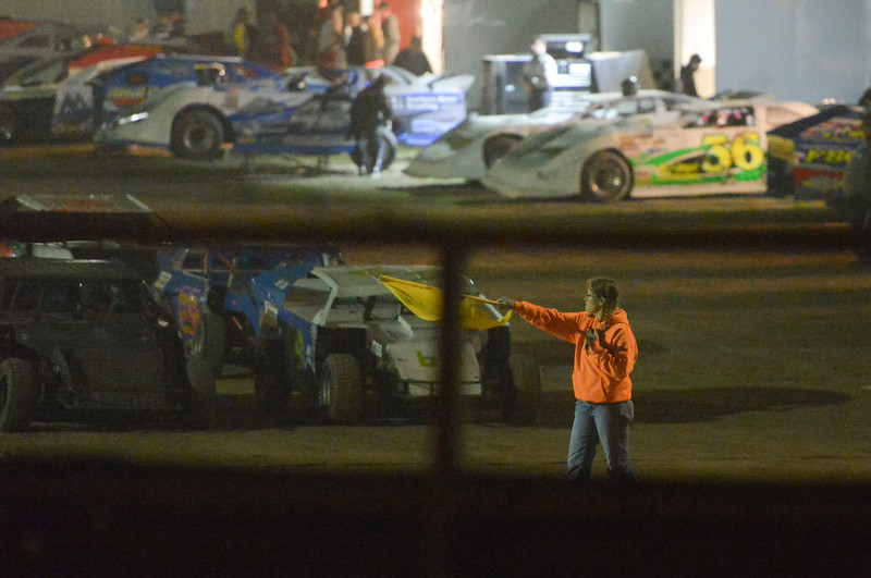 Justin Sheely | The Sheridan Press<br /> A race official signals the drivers during the I-90 Challenge for the final event of the season Saturday night at Sheridan Speedway.