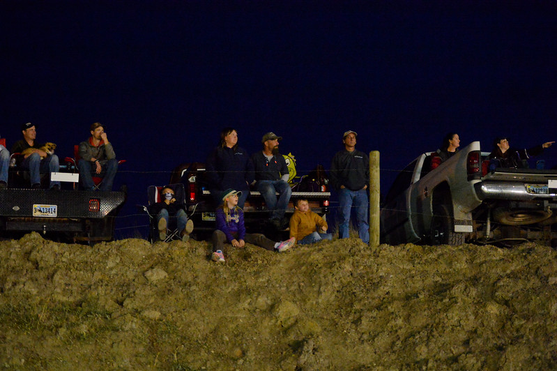 Justin Sheely | The Sheridan Press<br /> Spectators watch cars race on the dirt track during the I-90 Challenge for the final event of the season Saturday night at Sheridan Speedway.