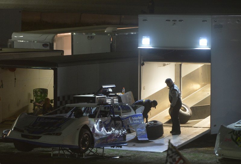 Justin Sheely | The Sheridan Press<br /> A driver and his mechanic get ready in the pit during the I-90 Challenge for the final event of the season Saturday night at Sheridan Speedway.
