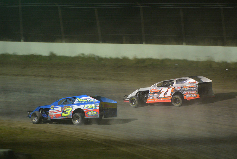 Justin Sheely | The Sheridan Press<br /> Brian Brennan (3b) and Cole Marlatt race their IMCA A Mods during the I-90 Challenge for the final event of the season Saturday night at Sheridan Speedway.