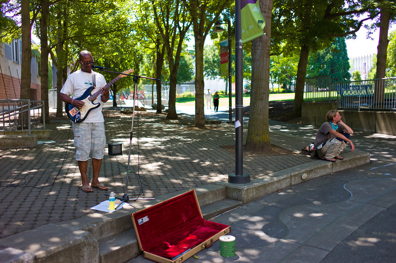 This guy was doing Hendrix covers, and I think everyone shot him. I was really trying to get the shot with the other guy in the background, but not with him staring at me. Took some waiting, but I got it.