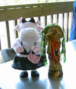 """The cow dances and sings """"Lady's Night,"""" and that's HJ (Headless Jesus) next to her.  Long story about HJ..."""
