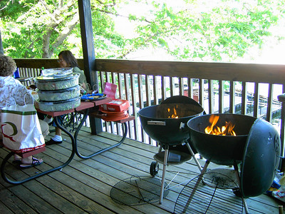 The coals are lit for the hotdog/brat roast for Friday dinner.  Look at all that salad on the picnic table!