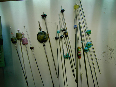 A batch of beads already out of the kiln on Friday evening.