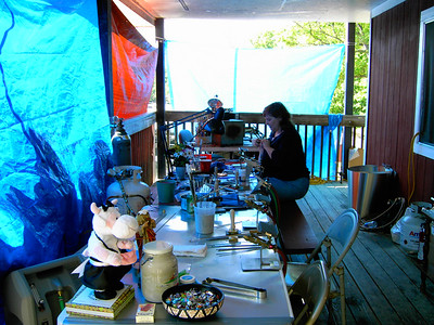 Saturday torching.  The tarps are up to shield the sun.  There are six torches here, counting Brian's in the corner.